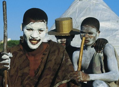 This photo by funkydoodledonkey is Xhosa boys shown wearing the white clay painted on their bodies that signifies transition to manhood. Around the teen years, Xhosa males traditionally are initiated into adulthood. The initiation includes a period of separation from family, during which older men mentor the younger ones. Still widely observed in rural areas, the initiation ends with the rite of circumcision.